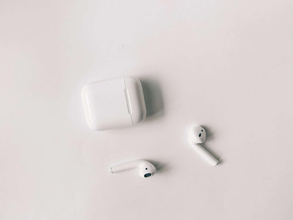 AirPods and case on white background